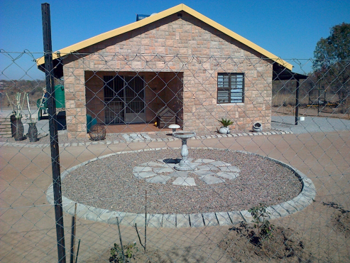 8.5 hec Plot with 2 bed room house for sale.