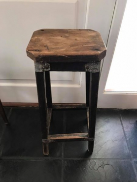 beautiful old barstool with metal detail