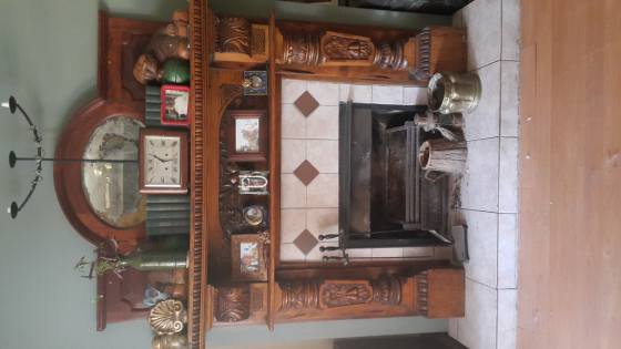 Hand Carved wooden fireplace surround. Section above with mirror included but not part of fireplace.