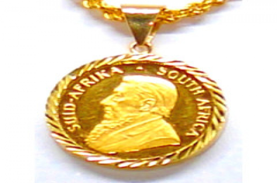22ct Gold 1/10 Kruger coin with a 9ct gold engraved casing