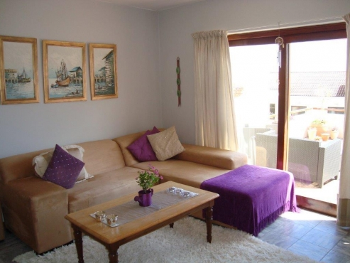 Unfurnished 3 bedroom TownHouse in Camps Bay with views, garage, parking bay and pool.