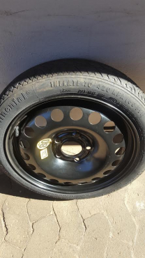 One 5 hole Opel Astra 16 inch Spare Saver Biscuit Spare Wheel with Continental Tyre