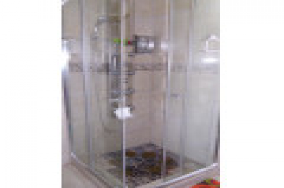 Modern stainless steel shower unit with massage sprayers