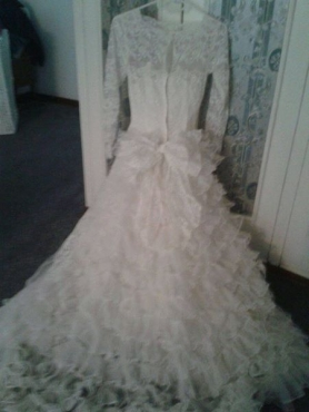 Vintage white lace wedding dress with petticoat