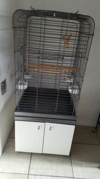 Two bird cages for sale.