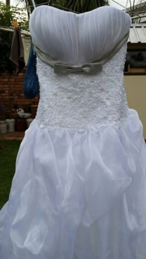 Wedding dress for sale - size 34 (with strapping) - urgent sale - relocating