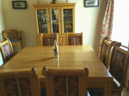 Solid Oak wooden dining room table & chairs and matching buffet
