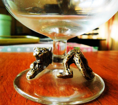 Wild Africa Cream Liqueur Glasses, metal (brass) Leopards at the base R30 for BOTH.