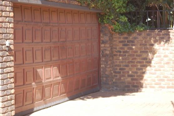 Double Wooden Garage Door Junk Mail