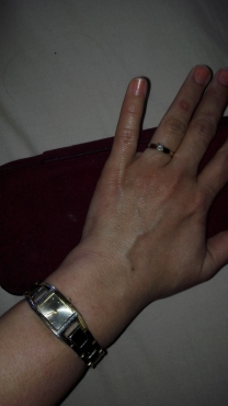 0.3 Carat solitaire gold and white gold ring and gold and silver plated Anne Klein watch from Canada