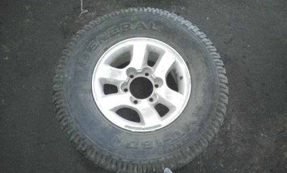 Colt rim & tyre for sale.
