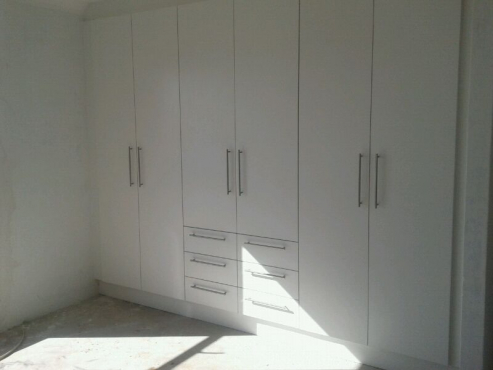 Custom made and installation of kitchen cupboards, bedroom cupboards, etc