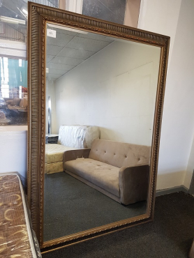 Mirror in gold frame
