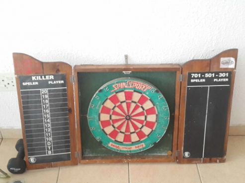 Dartboard in case with darts