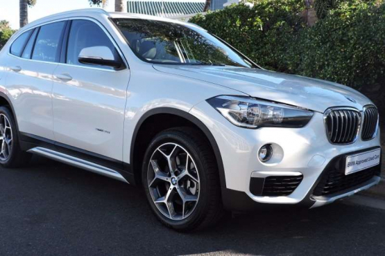 2017 BMW X1 sDrive20i SAV Mineral White Metallic Leathertec Black 1000 KilometersBalance of Motorplan, valid till 30/07/2022 or 100000 KilometersY-spoke style 569, 18225/50 R18 xLine ConnectedDrive services packageSport leather steering wheel (3 spoke) Interior trim finishers  Roof rails Aluminium satinated Luggage compartment net Seat adjustmentrear seats  TeleServices Telematics and Online Service provider controlCar jack and wrench Cruise Control with Brake Function  Exterior contents in satinised aluminium  Larger-capacity fuel tank Park Distance Control (PDC) Rear Sport leather steering wheel (3 spoke)  Y-spoke style 56918, 225/50 R18Interior trim finishers  Pearl  dark with highlight trim fin. Pearl Chrome Vehicle in Excellent ConditionR 549 900.00Finance can be ArrangedTerms and Conditions Apply