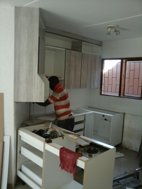 Door hanging kitchen cupboards ceiling company painting for Kitchen cupboards gauteng