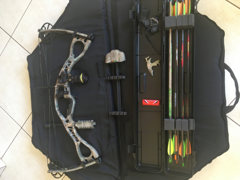 Compound bow ready to shoot with loads of extras