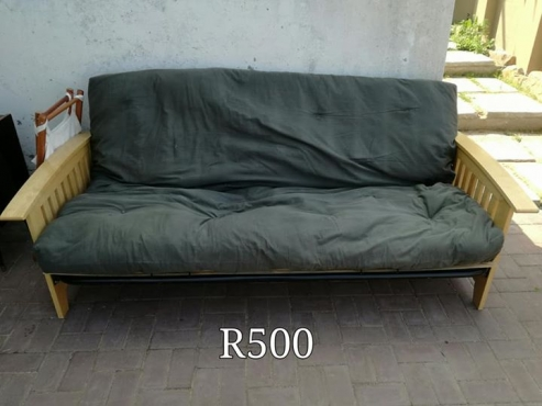 Wooden couch for sale.