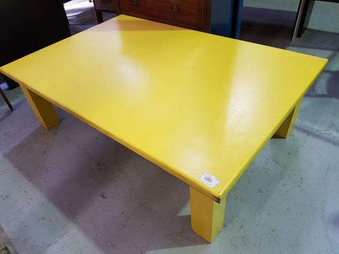 Yellow wooden coffee table