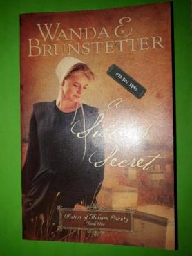 A Sister's Secret - Wanda E. Brunstetter - Sisters Of Holmes County #1.