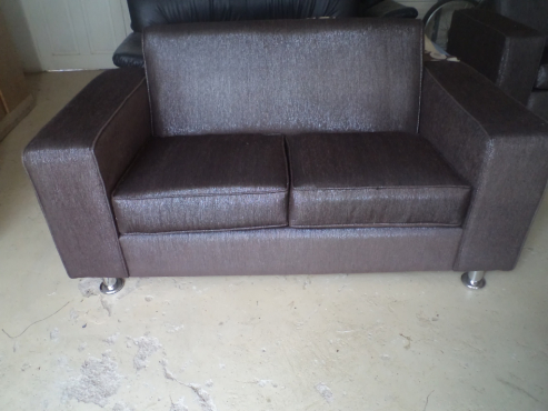 New 2 x 2 seater couches in brown glitter fabric beautiful must be seen to be appreciated
